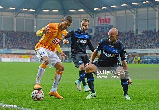 Alban Meha and Daniel Brueckner of Paderborn tackle Marcel Ndjeng of Berlin during the Bundesliga match between SC Paderborn and Hertha BSC at...