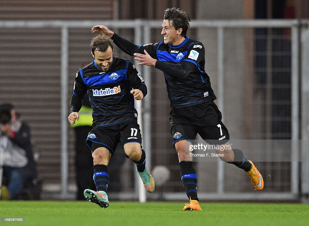 Alban Meha and Jens Wemmer of Paderborn celebrate their teams third goal during the Bundesliga match between SC Paderborn and Hertha BSC at Benteler...