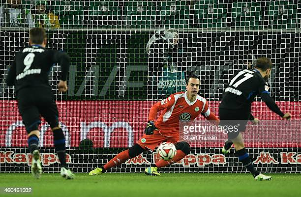 Alban Meha of Paderborn scores his team's first goal with a penalty against goalkeeper Diego Benaglio of Wolfsburg during the Bundesliga match...