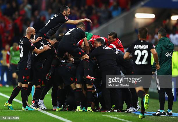 Albania players celebrate their team's first goal scored by Armando Sadiku during the UEFA EURO 2016 Group A match between Romania and Albania at...