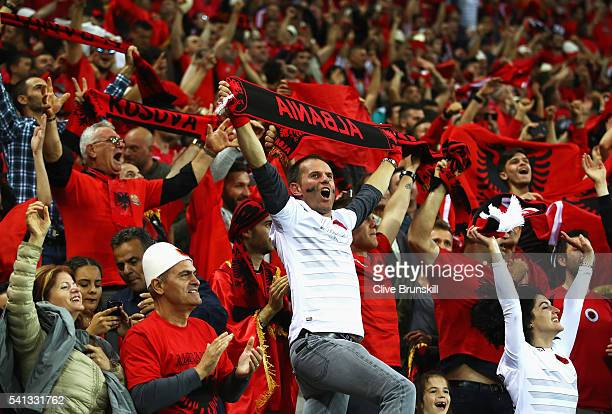 Albania supporters celebrate their team's first goal during the UEFA EURO 2016 Group A match between Romania and Albania at Stade des Lumieres on...