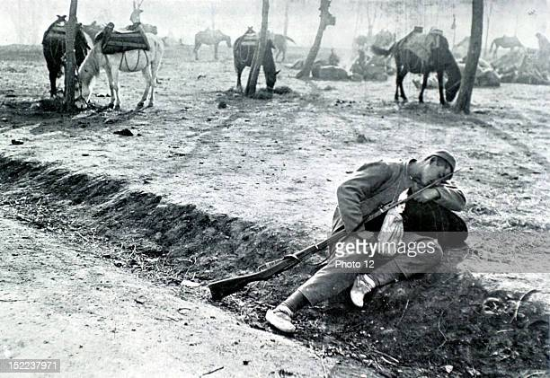 Albania War of the Balkans A young Montenegro soldier sleeping on the side of a road