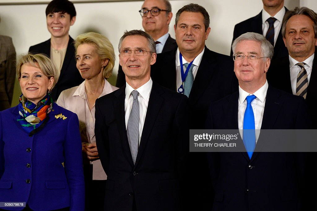 Albanian Defence Minister Mimi Kodheli, Nato Secretary General Jens Stoltenberg, British Defence Minister Michael Fallon, (2nd row, from L) German Defence Minister Ursula von der Leyen, Greek Defence Minister Panos Kammenos, (3rd row, from L) Norwegian Defence Minister Ine Marie Eriksen Soreide and Potugal's defence Minister Jose Alberto Azeredo Lopes pose for a family photo following following the North Atlantic Council (NAC) of Defence Ministers at NATO headquarter in Brussels on February 10, 2016. NATO defence ministers convene a two-day meeting to discuss current defense issues and whether the Alliance should take a more direct role in dealing with its gravest migrant crisis since Worl War II. / AFP / THIERRY CHARLIER