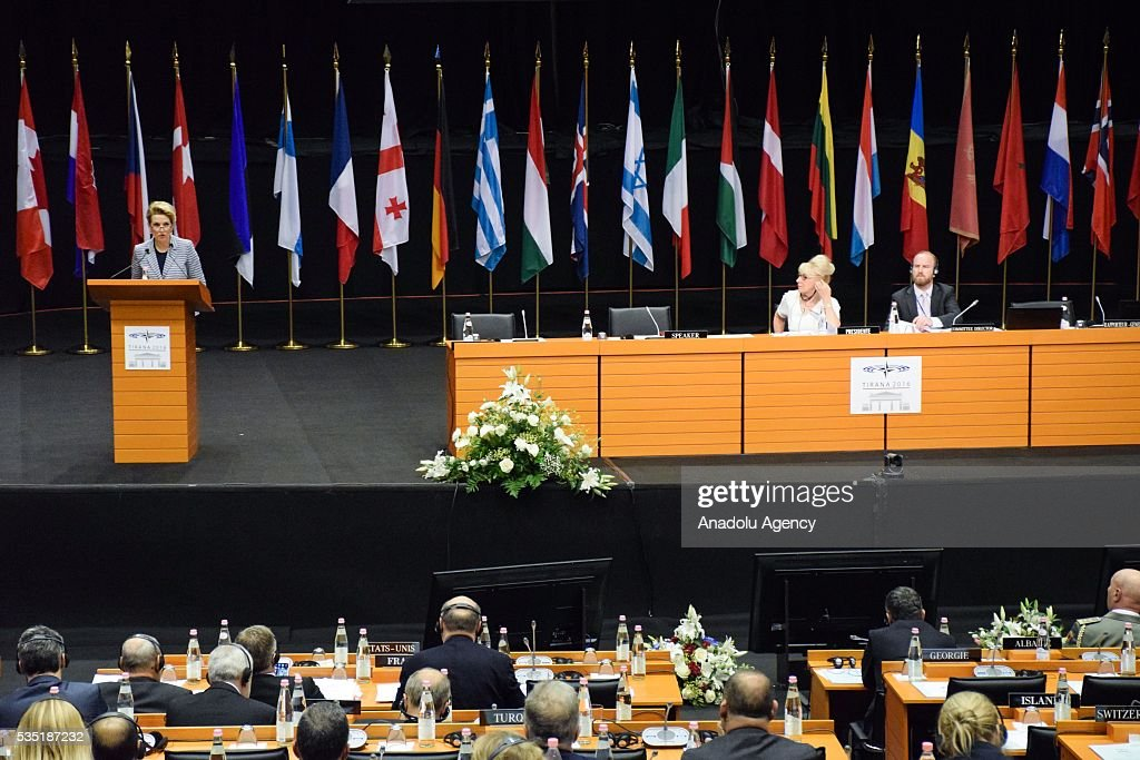 Albanian Defense Minister Mimi Kodheli (L) delivers a speech during the 'Defense and Security Commission Panel' as part of the NATO Parliamentary Assembly Spring session in Tirana, Albania on May 29, 2016.