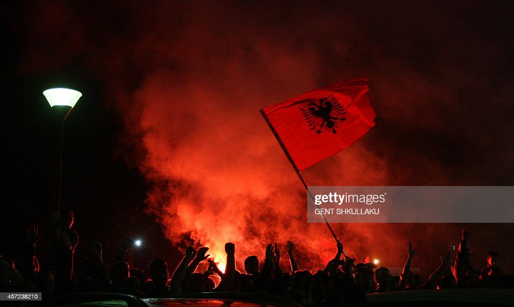Albanian fans await the arrival of the national soccer team following the abandoned Euro 2016 qualifying match between Albania and Serbia at Tirana's...
