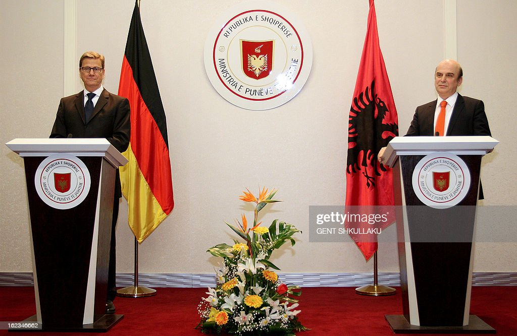 Albanian Foreign Affairs minister Edmond Panariti (R) and his German counterpart Guido Westerwelle (L) give a press conference after a meeting in Tirana on February 22, 2013. German Foreign Minister Guido Westerwelle is on a two-day official visit to Tirana to discus about the situation prior the general election in Albania. AFP PHOTO / GENT SHKULLAKU