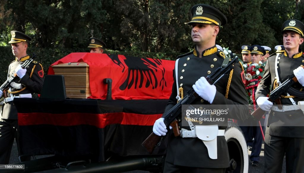 Albanian honour guards escort the coffin with the remains of Albania's self-proclaimed king Zog I during the reburial ceremony in Tirana on November 17, 2012. Thousands of Albanians turned out today to pay their respects to the late self-proclaimed king Zog I, whose remains are to be reburied with state honours after they were returned from France where he died in exile in 1961.