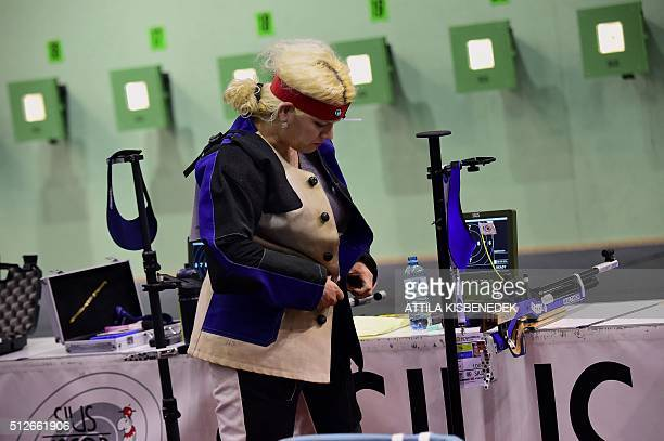 Albanian Lumturi Pepa adjusts her special coat prior to the qualification round of 10m air rifle category for women in AUDI Arena of Gyor on February...