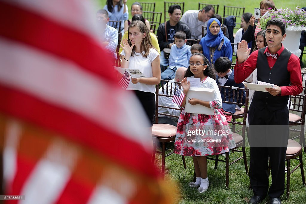 Albanian native Elisabeta Gjoka, 13; Ethiopian native Kidist Getachew, 9; and Pakistani native Annan Zulfiqar, 13, swear the oath of allegiance during a childrens citizenship ceremony at President Lincoln's Cottage at the Soldiers' Home May 2, 2016 in Washington, DC. Twenty one children from 19 countries, including Syria, South Korea and El Salvador, became new United States citizens during the ceremony sponsored by the U.S. Citizenship and Immigration Services. President Abraham Lincoln and his family resided seasonally on the grounds of the Soldiers' Home to escape the heat and politics of downtown Washington, as did President James Buchanan before him and presidents Rutherford B. Hayes and Chester A. Arthur from 1885 to 1887.