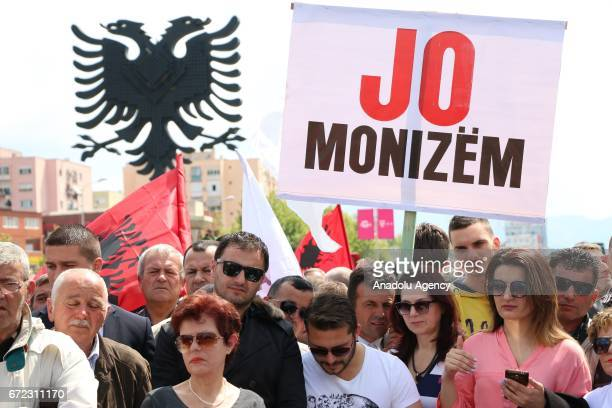 Albanian oppositions hold flags and placards during an unauthorized demonstration in Tirana Albania on April 24 2017