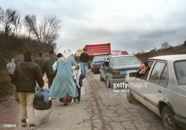 Albanian refugees from the Presevo valley in southern Serbia arrive at the American KFOR controlled sector of Kosovo at the Mucibaba border crossing...