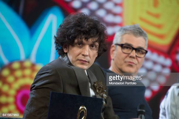 Albanian singer Ermal Meta attends at the third night of 'Dopo Festival' He holds the cover night award in his hands Sanremo February 9 2017