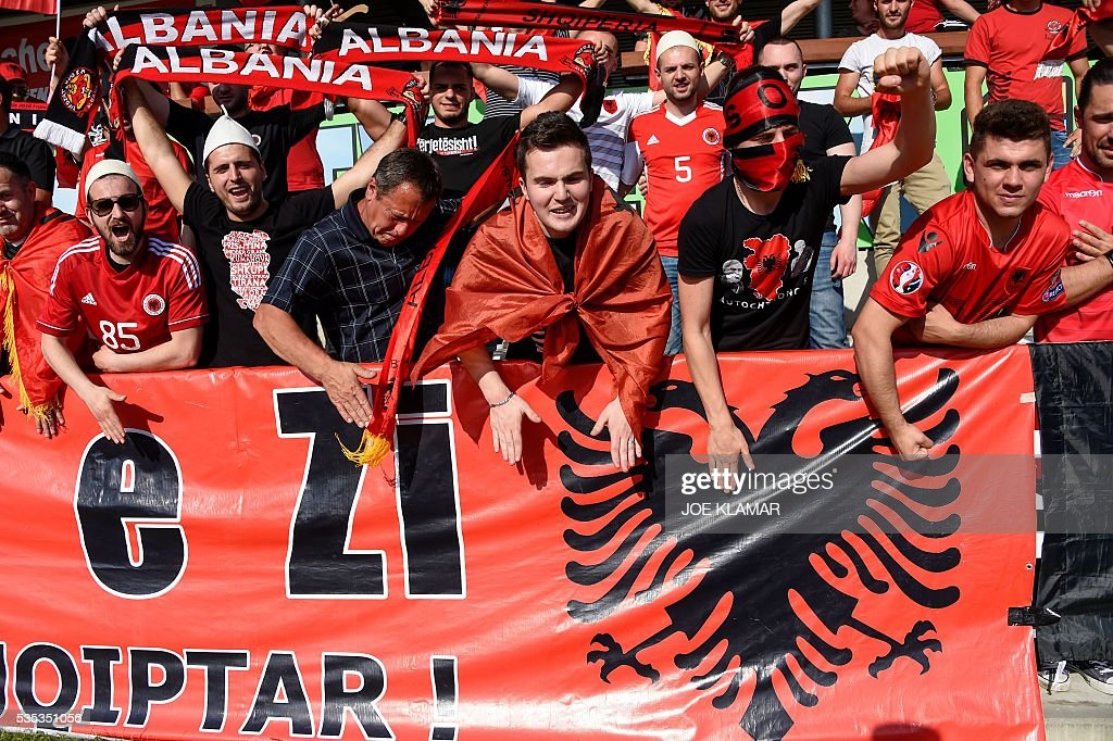 Albanian supporters cheer their team during the friendly football match between Albania and Qatar in Hartberg, Austria, on May 29, 2016. / AFP / JOE