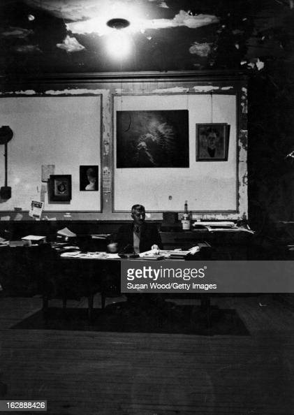 Albanianborn American photographer Gjon Mili sits at a desk in his loft New York New York 1962