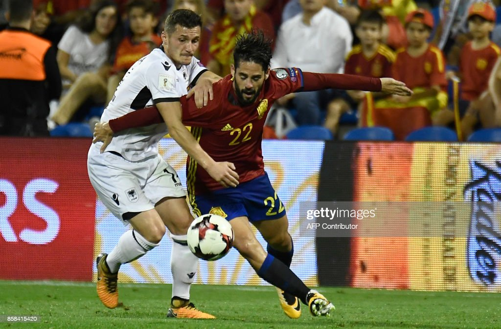 Albanian's midfielder Taulant Xhaka (L) vies with Spain's midfielder Isco during the World Cup 2018 qualifier football match Spain vs Albania at the Jose Rico Perez stadium in Alicante on October 6, 2017. /