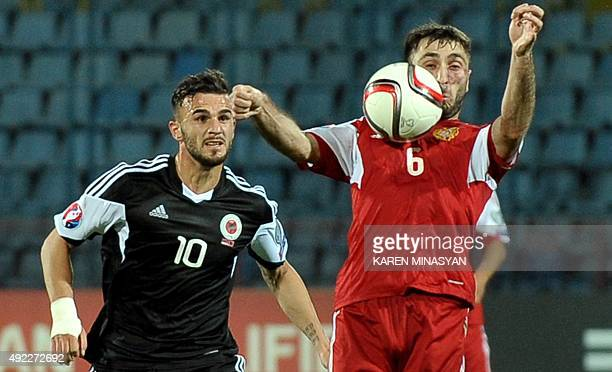 Albania's Armando Sadiku vies for the ball with Armenia's Karlen Mkrtchyan during the Euro 2016 group I qualifying football match between Armenia and...