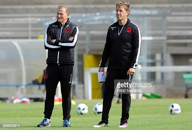 Albania's coach Gianni De Biasi and assistant coach Paolo Tramezzani attend a training session in PerrosGuirec western France on June 12 2016 during...