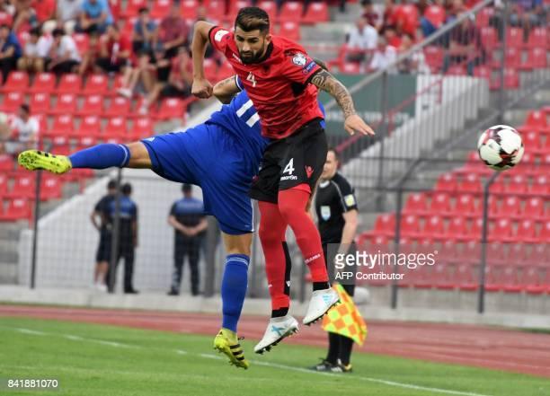 Albania's defender Eseid Hysaj fights for the ball with Liechtenstein's midfielder Franz Burgmeier during the FIFA World Cup 2018 qualification...