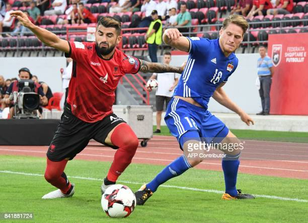 Albania's defender Eseid Hysaj fights for the ball with Liechtenstein's midfielder Nicolas Hasler during the FIFA World Cup 2018 qualification...