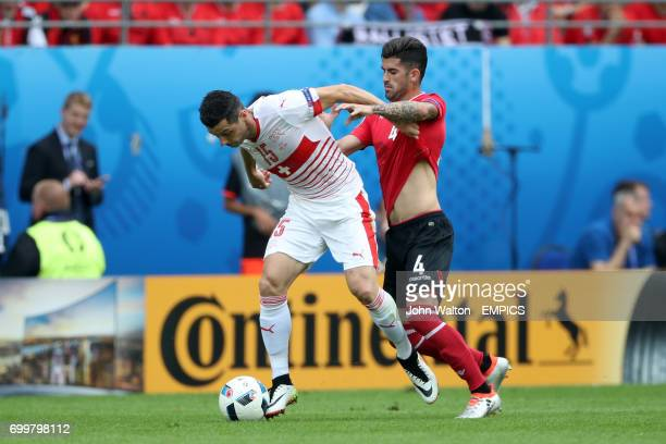Albania's Elseid Hysaj pulls back on Switzerland's Blerim Dzemaili during the Group B game at the Stade BollaertDelelis in Lens