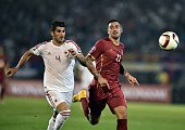 Albania's Elseid Hysaj vies with Serbia's Aleksandar Kolarov during the Euro 2016 group I qualifying football match between Serbia and Albania in...