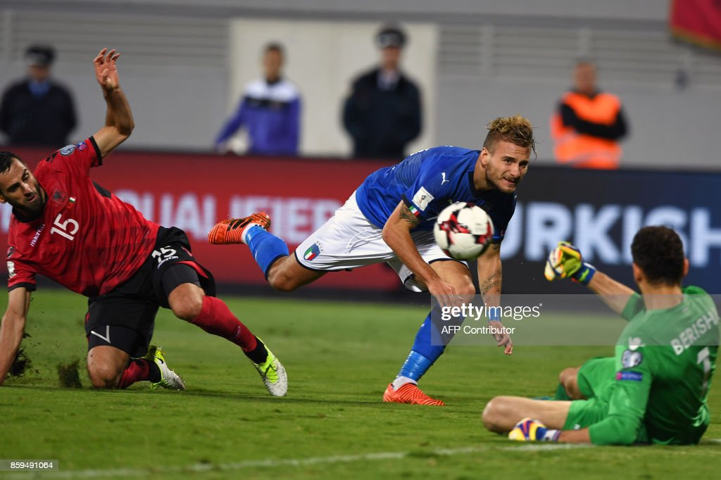 Albania's goalkeeper Etrit Berisha (R) saves a shot by Italy's Albania's midfielder Ciro Immobile (C) during the FIFA World Cup 2018 qualification football match between Albania and Italy at Loro Borici Stadium in Shkoder on October 9, 2017. / AFP PHOTO / Dimitar DILKOFF