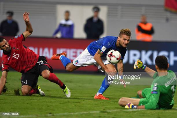 Albania's goalkeeper Etrit Berisha saves a shot by Italy's Albania's midfielder Ciro Immobile during the FIFA World Cup 2018 qualification football...