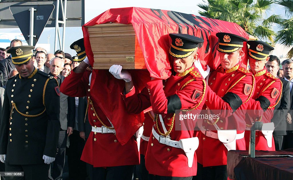 Albania's honour guards carry the coffin with the remains of Albania's self-proclaimed king, Zog I, arrived back in his home country today from France, where he died in exile in 1961, for reburial, on November 16, 2012 at Mother Teresa International Airport in Tirana. Zog's remains are due to be buried in a newly built mausoleum for the royal family in an official ceremony on November 17.