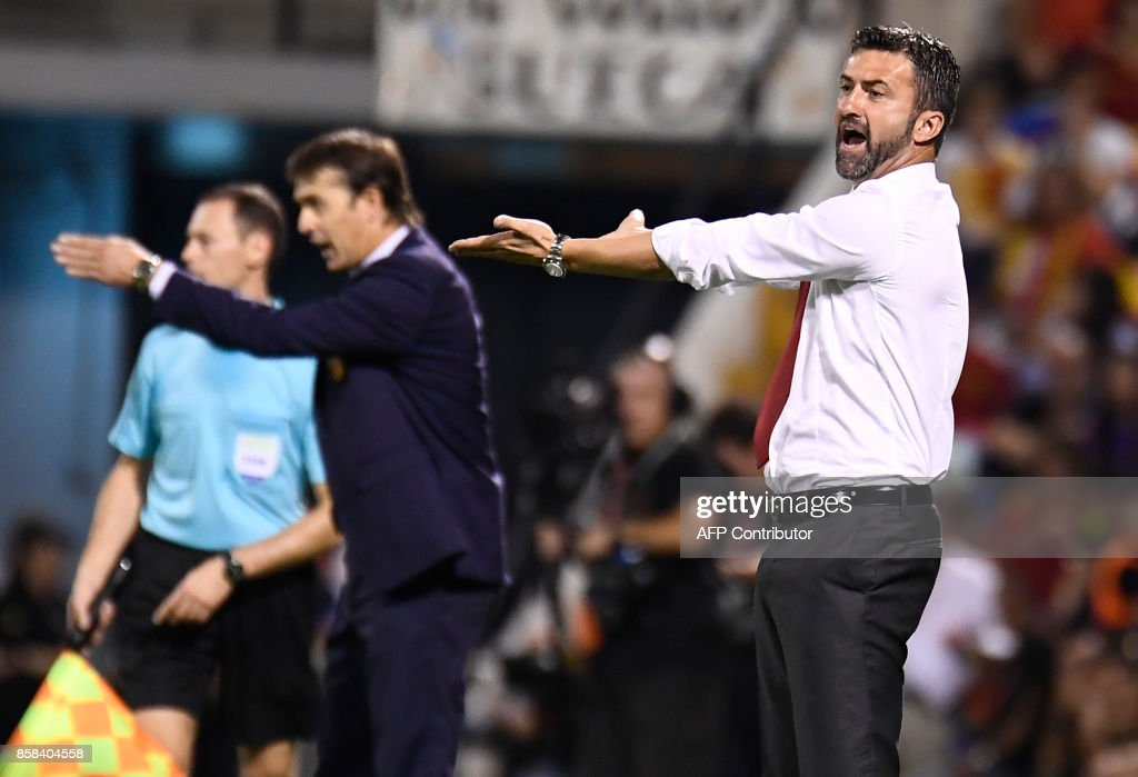 Albania's Italian coach Christian Panucci (R) and Spain's coach Julen Lopetegui gesture from the sideline during the World Cup 2018 qualifier football match Spain vs Albania at the Jose Rico Perez stadium in Alicante on October 6, 2017. /