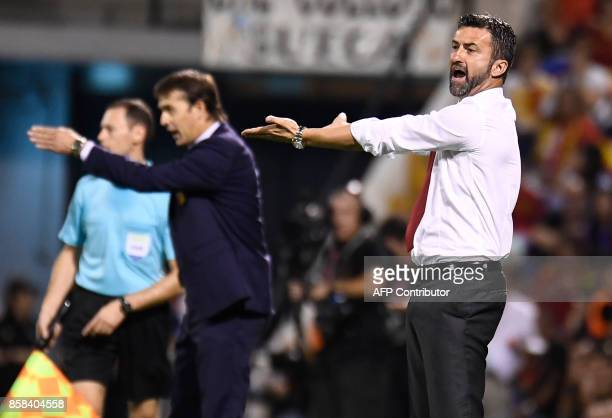 Albania's Italian coach Christian Panucci and Spain's coach Julen Lopetegui gesture from the sideline during the World Cup 2018 qualifier football...