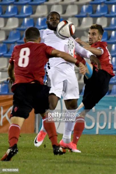 Albania's Kejdi Bare and Endri Cekici and vie with France's Olivier Ntcham during the friendly U21 international football match between Albania and...