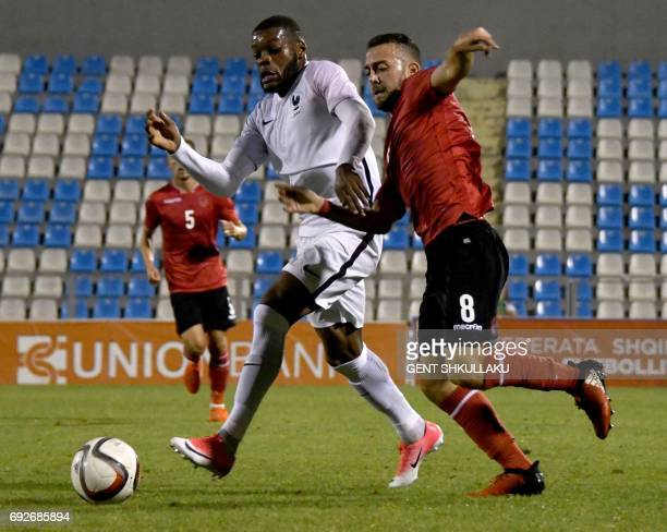 Albania's Kejdi Bare and vies with France's Olivier Ntcham during the friendly U21 international football match between Albania and France on June 5...
