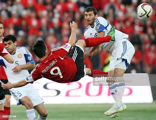 Albania's Ledian Memushaj challenges Armenia's Hovhannes Hambardzumyan during the Euro 2016 group I qualifying football match between Albania and...