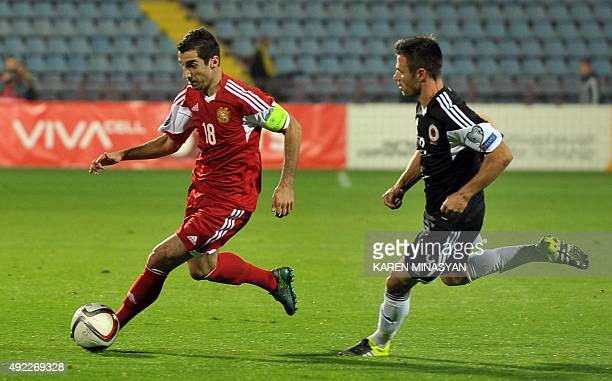 Albania's Ledian Memushaj vies for the ball with Armenia's Henrikh Mkhitaryan during the Euro 2016 group I qualifying football match between Armenia...