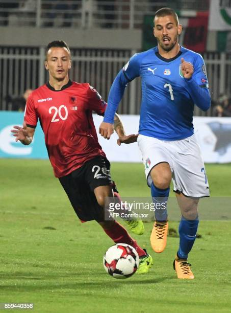 Albania's midfielder Ergys Kace vies with Italy's defender Leonardo Spinazzola during the FIFA World Cup 2018 qualification football match between...