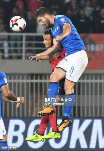 Albania's midfielder Ergys Kace vies with Italy's midfielder Roberto Gagliardini during the FIFA World Cup 2018 qualification football match between...
