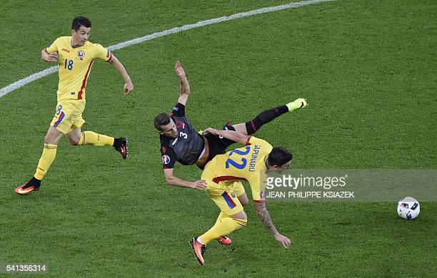 TOPSHOT Albania's midfielder Ermir Lenjani vies with Romania's defender Cristian Sapunaru during the Euro 2016 group A football match between Romania...
