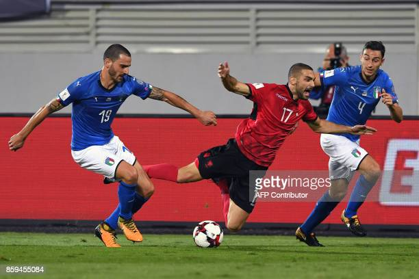 Albania's midfielder Eros Grezda vies with Italy's defender Leonardo Bonucci and Italy's defender Matteo Darmian during the FIFA World Cup 2018...