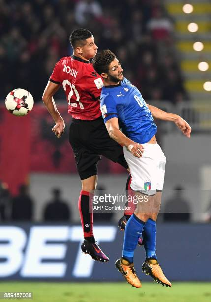 Albania's midfielder Odise Roshi vies with Italy's midfielder Roberto Gagliardini during the FIFA World Cup 2018 qualification football match between...