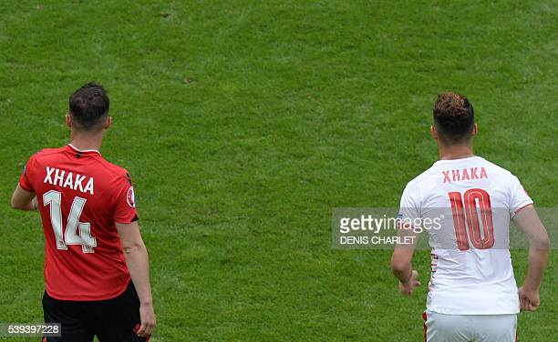 Albania's midfielder Taulant Xhaka walks next to his brother Switzerland's midfielder Granit Xhaka during the Euro 2016 group A football match...