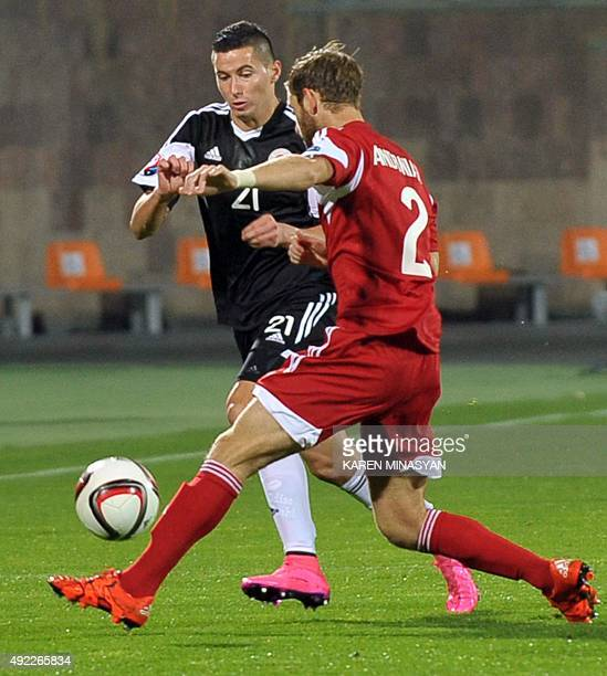 Albania's Odise Roshi vies for a ball with Armenia's Gael Andonian during the Euro 2016 group I qualifying football match between Armenia and Albania...