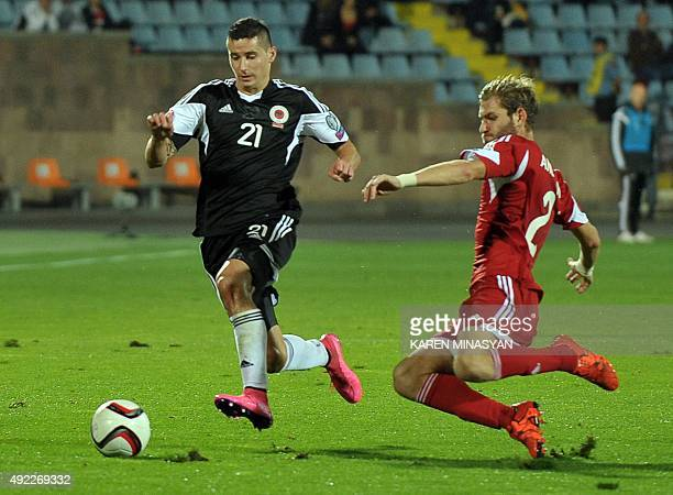 Albania's Odise Roshi vies for the ball with Armenia's Gael Andonian during the Euro 2016 group I qualifying football match between Armenia and...