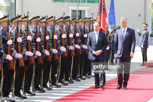 Albania's President Bujar Nishani is welcomed by President of Kosovo Hashim Thaci during an official welcoming ceremony in Pristina Kosovo on May 11...