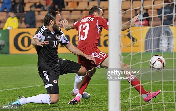 Albania's Shkelzen Gashi vies with Armenia's Kamo Hovhannisyan during the Euro 2016 group I qualifying football match between Armenia and Albania on...