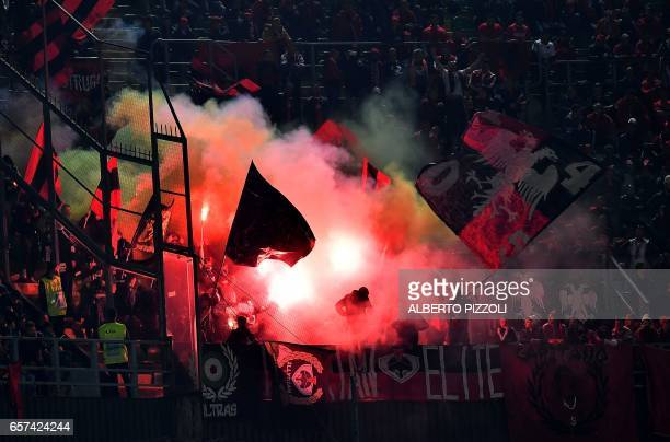 Albania's supporters light flares in the stands during the FIFA World Cup 2018 qualification football match between Italy and Albania on March 24...