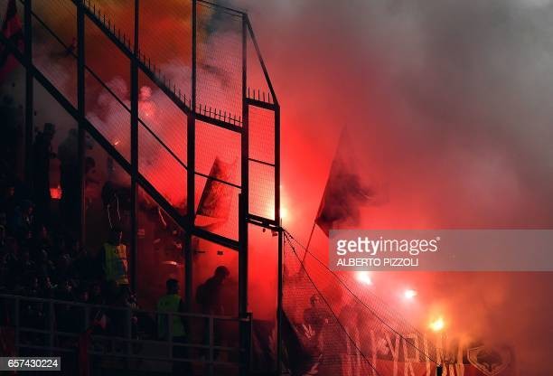 Albania's supporters throw smoke bombs and flares during the FIFA World Cup 2018 qualification football match between Italy and Albania on March 24...