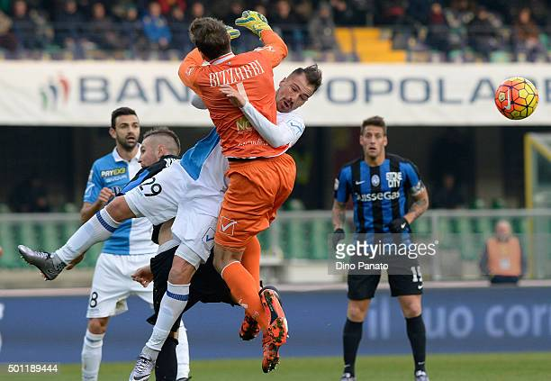 Albano Bizzarri goalkeeper of Chievo Verona is challenged to his team's mate Fabrizio Cacciatore during the Serie A match between AC Chievo Verona...