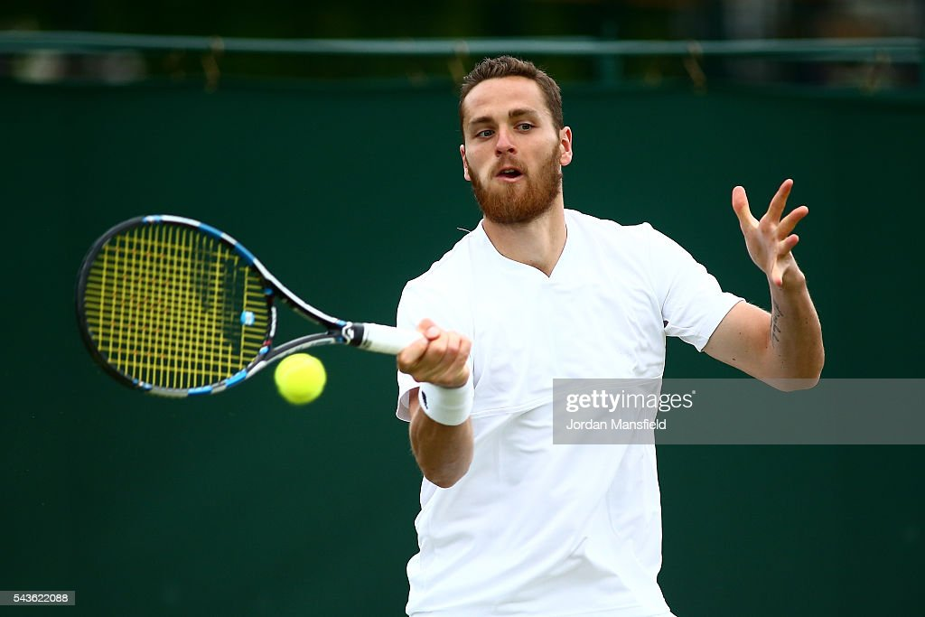 Albano Olivetti of France plays a forehand during his Men's Singles first round match against Matthew Baton of Australia during day three of the Wimbledon Lawn Tennis Championships at the All England Lawn Tennis and Croquet Club on June 29, 2016 in London, England.