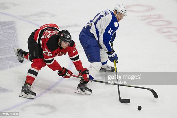 Albany Devils left wing Ben Thomson messes up Toronto Marlies right wing Zach Hyman from keeping control of the puck in the offensive end Toronto...