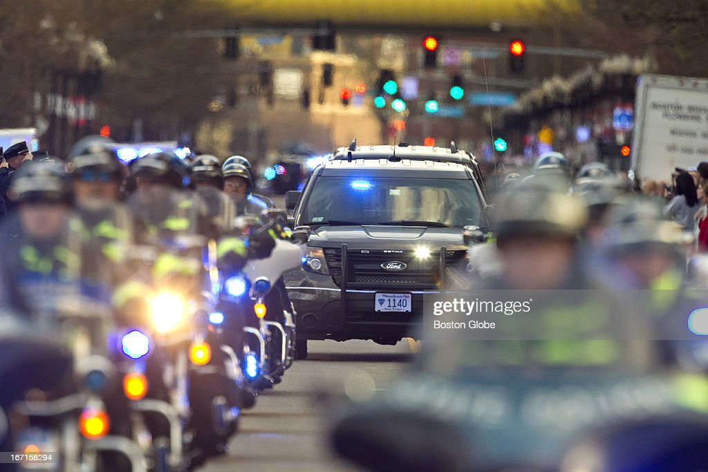 Albany Street is lined with officers, firefighters and civilians during a procession for MIT officer Sean Collier, 26, of Somerville, as his body is driven from the Medical Examiner to Wilmington on Saturday, April 20, 2013.